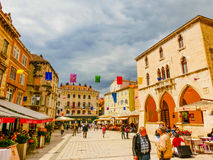 Split, Croatia - May 08, 2014: Tourists walk in the Old City on a cloudy summer day Stock Photos