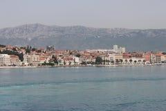 Split, Croatia (Split view from the ferry). Split view from the ferry. Sea, coast, city and behind the mountains Stock Photo