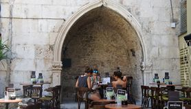 Split, Croatia - 07/22/2015 - Tourists enjoy cafes in old town, beautiful architecture, sunny day, Dalmatia stock photography