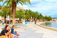 Split embankment. SPLIT, CROATIA - JULY 28, 2014: Unidentified people eating ice cream on the embankment of Split. Split is the second-largest city of Croatia Royalty Free Stock Photography