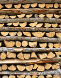 Split firewood in heap Stock Images