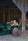 Split firewood in an old wood shed Royalty Free Stock Image