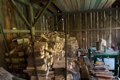 Split firewood in an old wood shed Royalty Free Stock Photography