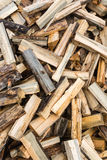 Split firewood. Texture with a stab firewood. Firewood randomly scattered across the frame stock photography