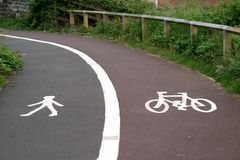 Split footway and cycleway. Split cycle and footway with symbols Royalty Free Stock Images