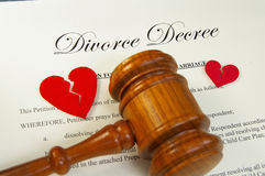 The split - gavel divorce. Broken red hearts and legal gavel on divorce papers Stock Images