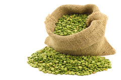 Split green peas in a burlap bag Stock Images
