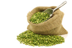 Split green peas in a burlap bag Stock Image