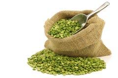 Split green peas in a burlap bag stock image