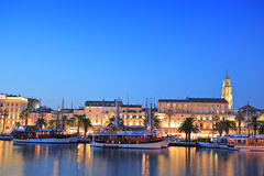 Split harbour depicting Diocletian's palace. By night Stock Image