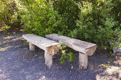 Split log park benches. Park benches made from split logs Stock Image