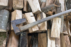 Split logs  for firewood with axe Stock Image