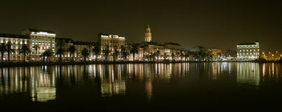 Split by night. Everyone who visit the Split say that the most beautiful city in the world. Panorama of Split (Riva) and reflection in Adriatic sea (Croatia Stock Photography