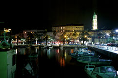 Split by Night. A nighttime view of the harbor of the historic town of Split, Croatia.  Diocletian's palace can be seen on the right side Stock Image