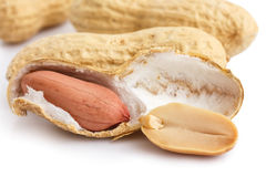 Split open peanut shells with nuts visible Royalty Free Stock Photos