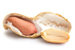 Split open peanut shells with nuts visible.  Stock Images