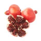 Split open pomegranate fruit Stock Images