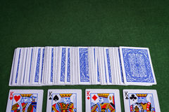 Split pack of playing cards showing Kings Royalty Free Stock Image
