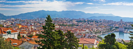 Split panoramic waterfront view of architecture and nature Royalty Free Stock Images