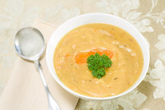 Split pea soup. Nutritious yellow split pea soup made with leftover ham bone Stock Image