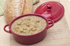 Split Pea Soup. In a Crock with Bread in the Background Stock Images