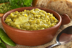 Split Pea Soup. With potato in rustic bowl (Selective Focus, Focus one third into the bowl Stock Photos