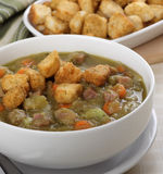 Split Pea Soup. Split pea and ham soup with croutons on top Royalty Free Stock Image