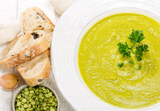 Split Pea Soup. Close up of delicious homemade split pea soup with garlic, bread and parsley for garnish Stock Photography