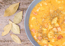 Split pea soup. Decorated with some bay leaves, marjoram and peas Royalty Free Stock Images