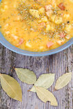 Split pea soup. Decorated with some bay leaves, peas and marjoram Royalty Free Stock Photos