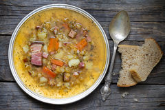 Split pea soup on vintage wooden table Royalty Free Stock Image
