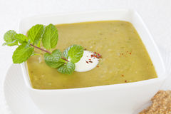 Split Pea Soup with Yoghurt and Mint. Homely split pea soup  with a dollop of yoghurt and mint Royalty Free Stock Photo