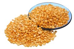 Split peas. And a blue saucer on a white background stock photos