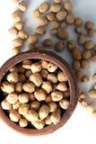 Split peas at terracotta jug Royalty Free Stock Images