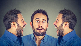 Split personality. Two angry men screaming at scared himself Royalty Free Stock Images