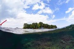 Split photo in sipadan water. Under over photo in sipadan water Stock Photos