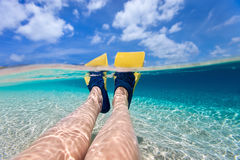 Split photo of  woman legs with fins Royalty Free Stock Images