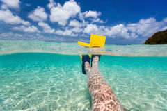 Split photo of  woman legs with fins Royalty Free Stock Photos