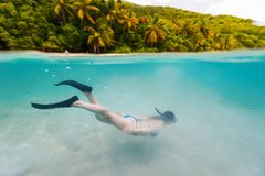 Woman snorkeling in tropical water Royalty Free Stock Image