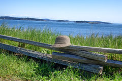 Split Rail Fence with Hat on water front Royalty Free Stock Image