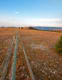 Split Rail Fence next to dirt road at sunrise above Lost Water Canyon USA Royalty Free Stock Photos