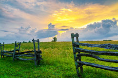 Split rail fence and sunset, Cumberland Gap Natl Park. A summer sunset, looking through this old split rail fence at Hensley Settlement in the Cumberland Gap Royalty Free Stock Photography