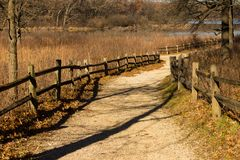 Split rail lined Gravel path at the Little Red Schoolhouse Nature Center. In Willow Springs, Illinois royalty free stock photos