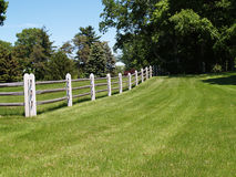 Split rail wood fence by a field Royalty Free Stock Photos