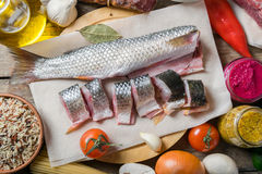 Split Raw Fish and Vegetables Stock Image