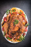 Split roasted turkey and vegetables Stock Image