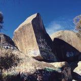 Split rock. Graffiti covered rock in Victoria Australia Royalty Free Stock Image