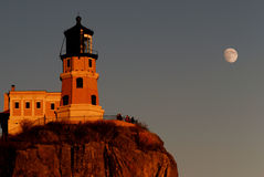Split rock lighthouse with the moon Stock Image