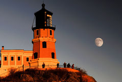 Split rock lighthouse with the moon Royalty Free Stock Images