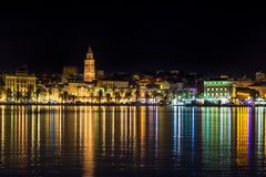 Split seafront and Bell tower of St Duje. Shot of Split`s seafront and walk by the sea at night. there is old part of town at photo, including St Duje bell tower Stock Photography